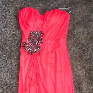 Long strapless dress, has a slit, neon pink/peach